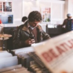 man looking at vintage records